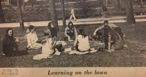 In my Peter Pan collar and box-pleated skirt, sitting on the lawn next to my French instructor with cigarette in her hand.